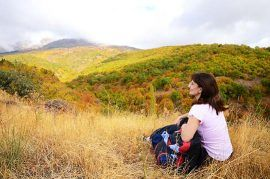 11030657-mid-age-woman-resting-on-the-grass-in-the-mountain-area-541x359px-q40